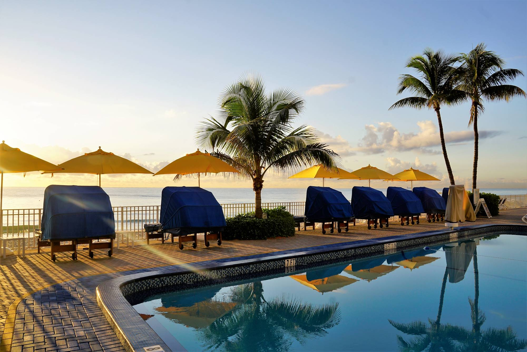 Sun bathing area by the pool at our Ft. Lauderdale Hotel